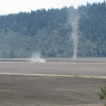 A tractor pulling a disk on the Running Y Ranch, near Klamath Falls, OR.