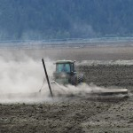 A tractor working a future wheat field on the Running Y Ranch, Klamath Falls, OR.