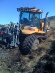 Caterpillar 865 stuck nose first in a field on the Running Y Ranch.