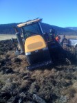 Front view of Caterpillar 865 stuck in a field on the Running Y Ranch.