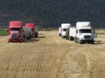 Four grain trucks at the Running Y Ranch waiting to be filled.