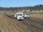 Two full potato trucks make their way out of a chipping potato field on the Running Y Ranch.