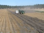 A potato bulker and spud truck harvesting chipping potatoes on the Running Y Ranch.