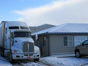 A truck and trailer operated by Gold Dust Potato Processors delivers potatoes to the Klamath Lake Counties Food Bank.