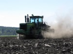 A John Deere 9620T discs a future chipping potato field at the Running Y Ranch.